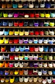 Stock Collection Of Colorful Ballerinas Shoes Shelves Store. A Number Of Womens Shoes Stained With D poster