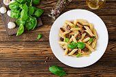 Vegetarian Vegetable Pasta Penne  With Mushrooms  In White Bowl On Wooden Table. Vegan Food. Top Vie poster