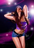 stock photo of rap-girl  - girl dancing in discolight - JPG