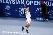 BUKIT JALIL, MALAYSIA- OCT 01: Japan's Kei Nishikori hits a backhand shot in this Malaysian Open sem