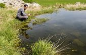 Scientist Measuring Environmental Water Quality In A Wetland Using A Multi-parameter Probe poster
