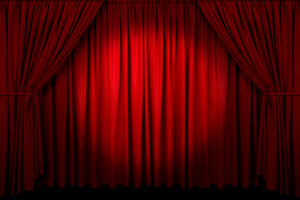 foto of curtains stage  - Large red curtain with spot light and fading into dark - JPG