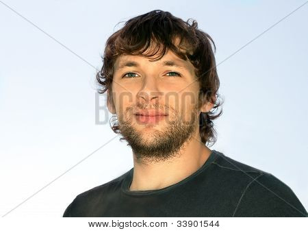 Young Man With ?urly Hair And Beard Face Attractive