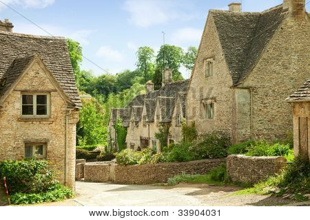 Traditional Cotswold cottages in England, UK. spring. Bibury is a village and civil parish in Gloucestershire, England.