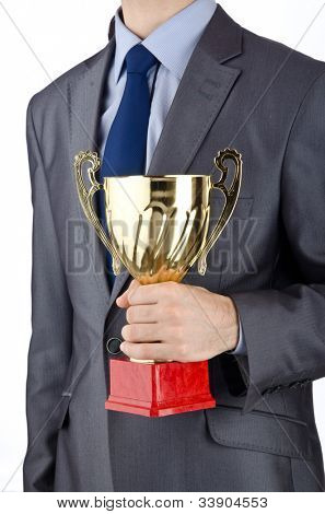 Man being awarded with golden cup