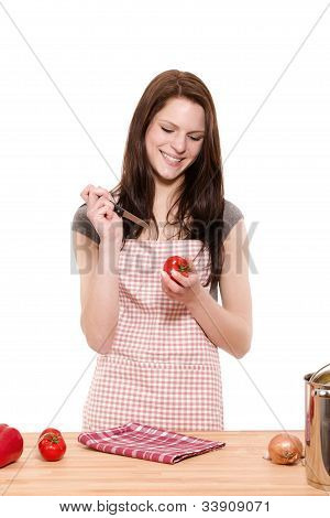woman about to cutting tomatoes