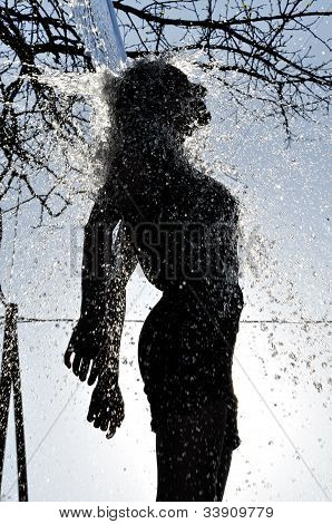 Sexy Woman Enjoys The Water Splash In The Outdoors