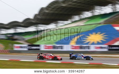 SEPANG - JUNE 9: A Honda HSV-010 (17) leads the Nissan GTR (23) during practice at the 2012 Autobacs SUPER GT Series Round 3 on June 9, 2012 at the Sepang International Circuit, Malaysia.