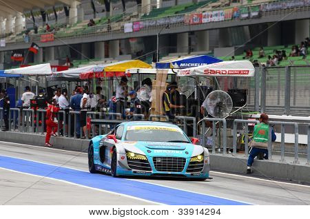 SEPANG - JUNE 9: The Audi R8 LMS car from APR team runs down the pit lane after a tire change at the 2012 Autobacs SUPER GT Series Rd 3 on June 9, 2012 at the Sepang International Circuit, Malaysia.