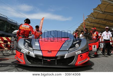 SEPANG - JUNE 10: The Arta Honda HSV-010 car of Autobacs Racing Team Aguri waits on the start grid at the Autobacs SUPER GT Series Rd 3 on June 10, 2012 at the Sepang International Circuit, Malaysia.