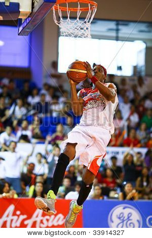 KUALA LUMPUR - JUNE 02: Tiras Wade of the Malaysia Dragons attempts a lay-up in a playoff match against San Miguel Beermen in the ASEAN Basketball League on June 02, 2012 in Kuala Lumpur, Malaysia.