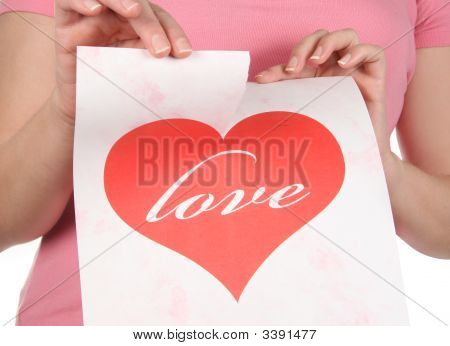 Woman Shredding A Paper Heart That Spells 'Love' On It.