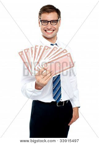 Cheerful Man Holding Up Playing Cards