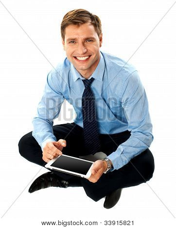 Man Sitting On Floor Using Touch Screen Device