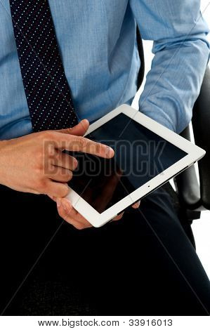 Closeup Shot Of Man Operating Tablet Pc