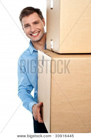 Smiling Young Man Holding Cardboard Boxes