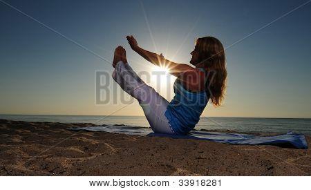 Full Boat Yoga Pose On Beach