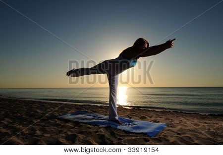 Warrior Iii Yoga Pose On Beach