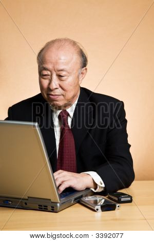 Working Asian Businessman