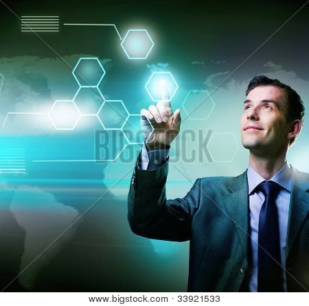 Businessman pressing high tech buttons on a virtual touchscreen interface