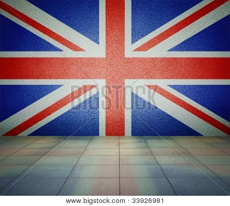 United Kingdom of Great Britain and Northern Ireland flag on the wall in empty room, studio background