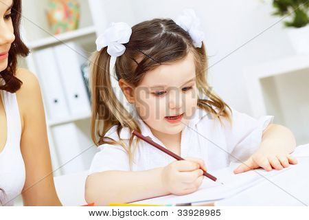 Mother and daughter studying