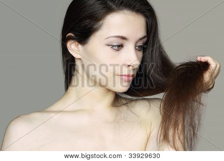 Care Of Damaged Woman Hair. Closeup Portrait Of Beautiful Woman Looking