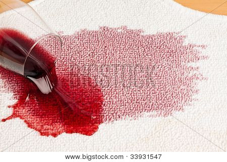 red wine is spilled on a carpet. reverse glass and all related