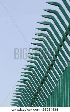Pointed Wrought Iron Bars Forged To Form A Fence