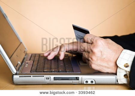 Senior Businessman Buying Online