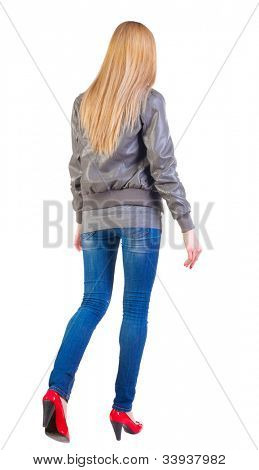 going woman back view . walking blonde girl in motion. during a walk. Rear view people collection.  backside view of person.  Isolated over white background.