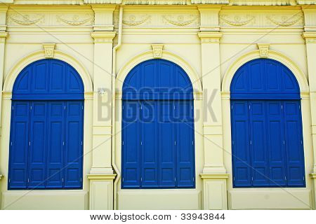 Blue door and yellow walls.