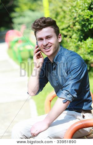 Russian Man In Park With Telephone