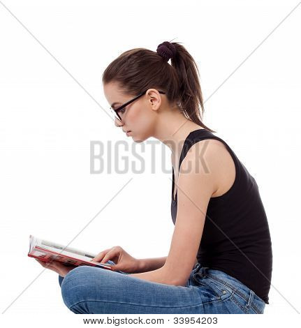 Portrait Of Teen Girl With A Book