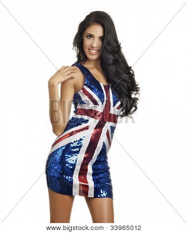 Beautiful young woman wearing British flag union jack flag dress.  Image isolated against white.