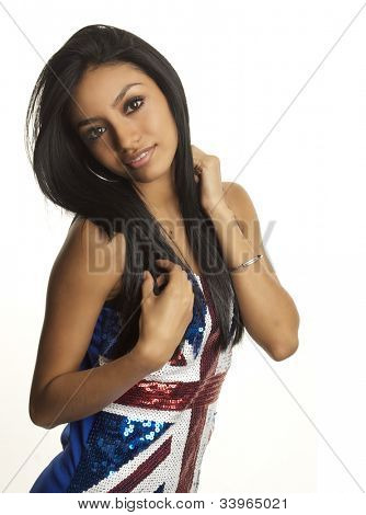 Pretty young woman smiling wearing union jack flag dress isolated against white background.