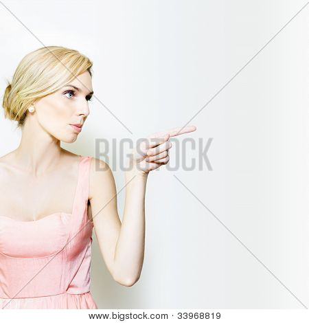 Beautiful Girl Pointing To Advertising Copyspace