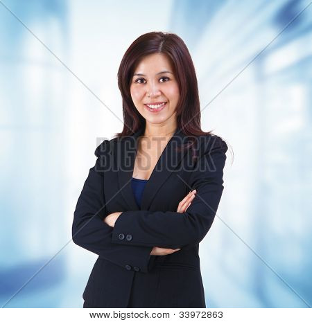 Mixed race Mid adult Asian woman standing on office background