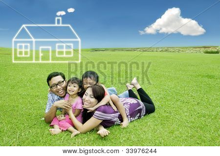 Asian Family With Dream House