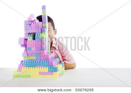 Boy Hiding Behind Blocks