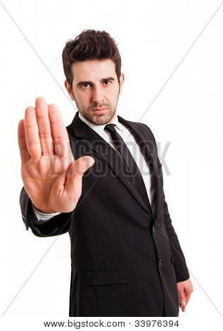 Businessman gestures STOP with his hand, isolated on white