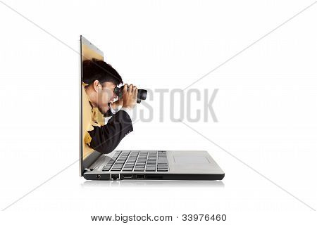Businessman With Binoculars From Laptop