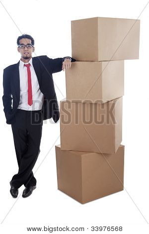 Businessman With Stack Of Cardboard
