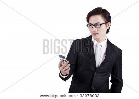 Shocked Businessman Reading Message