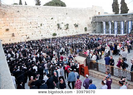 JERUSALEM,ISRAEL-APRIL 27:Jewish praying at the western wall on a jewish holiday on April 27.2012,Jerusalem, Israel. Iyar 5(April 27) celebrated as day when the state of Israel was proclaimed