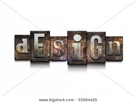 "The word ""design"". Random letterpress type on grunge background."