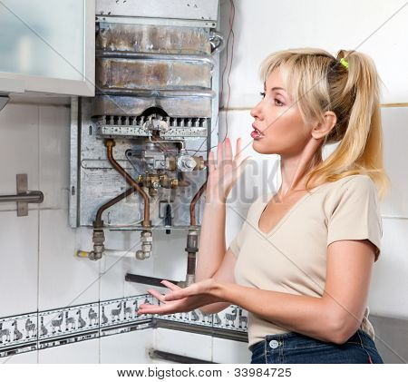 The housewife is afflicted the gas water heater broke