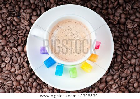 Multicolored Slabs Of Shugar And Cup Of Coffee