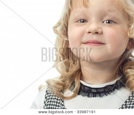 little child girl face closeup looking at camera  smiling isolated on white background