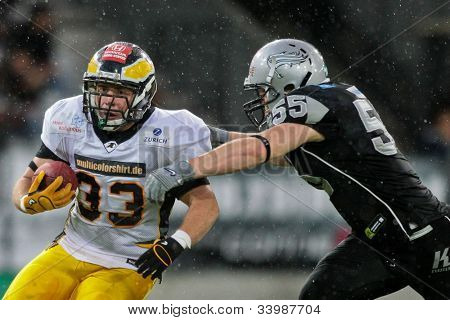 INNSBRUCK, VIENNA - JUNE 18: RB Clemens Niepagen (#33 Adler) is tackled by LB Christoph Schilcher (#55 Raiders) on June 18, 2012 in Innsbruck, Austria. The Swarco Raiders beat the Berlin Adler 27:12.